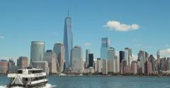 Boat sailing to New York City downtown buildings skyline 4k - stock footage