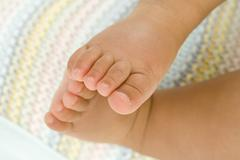 Baby boy (3-6 months), close-up of feet, low section Stock Photos