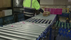 Parcels being pushed along a conveyer belt Stock Footage