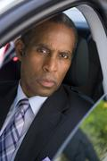 Businessman in car, portrait, elevated view Stock Photos