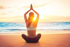 Stock Photo of yoga woman at sunset
