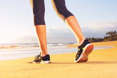 Athlete runner feet on the beach Stock Photos