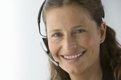 businesswoman with hands-free telephone headset - stock photo