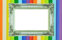 Vintage silver picture frame on rainbow colorful wall Stock Photos