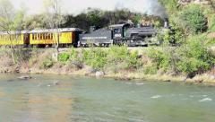 Durango Colorado historic steam train along river 4K 275 Stock Footage
