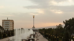 Stella with the emblem on the background of the fountains. Dushanbe. Tajikistan Stock Footage