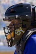 Close up of lacrosse player wearing helmet Kuvituskuvat