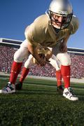 center snapping football to quarterback - stock photo