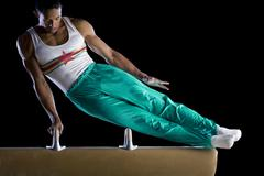 male gymnast performing on pommel horse, low angle view - stock photo
