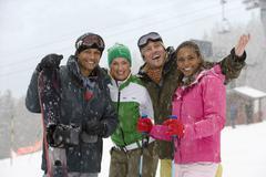Couples on ski vacation Stock Photos