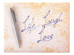 Old paper grunge background - life laugh love Stock Photos
