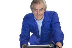 mechanic with diagnostic computer, portrait, cut out - stock photo