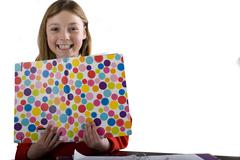 young girl holding colorful folder, cut out - stock photo