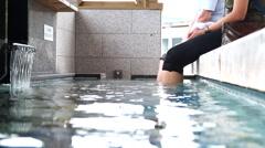 Open air foot bath onsen Stock Footage