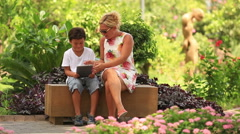 Mother and son using digital tablet Stock Footage