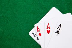 Quads on a green casino table with space for text Stock Photos