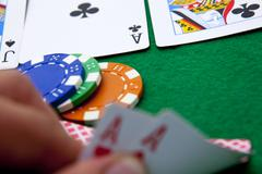 texas holdem pocket aces on casino table - stock photo