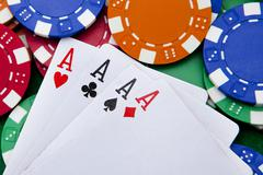poker, four aces over a background with casino chips - stock photo