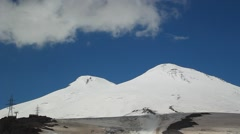 View of Europe's highest peak, Mount Elbrus, cloud flying over the mountain Stock Footage