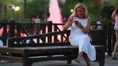 attractive blonde women talking smartphone - stock footage