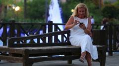 attractive blonde women using smartphone - stock footage