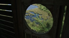 High angle view - look down through window from watchtower at peat lake Stock Footage