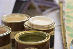 close-up of tins of paint (differential focus) - stock photo