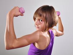 Child exercising with dumbells Stock Photos