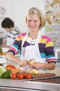 Smiling student preparing recipe in home economics class Stock Photos