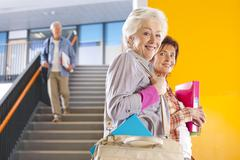 adult students in college arriving for evening classes - stock photo