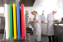 Close up of cutting boards in commercial kitchen Stock Photos