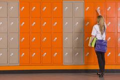 Student unlocking school locker Stock Photos