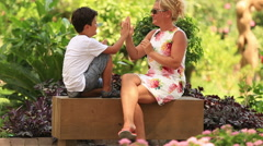mother and son relaxing time - stock footage