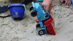 Boy in sand and machine Stock Footage