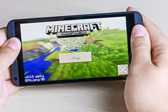 Minecraft computer game in the genre with elements of survival sandbox and op Stock Photos