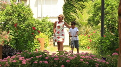 Mother and son walking in the park Stock Footage