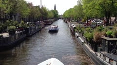 Canal cruise ships in Amsterdam passing by each other Stock Footage