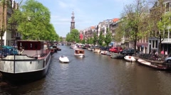 Tourism at the canals in Amsterdam, The Netherlands Stock Footage