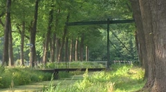 Drawbridge across peat canal Helenavaart, Griendtsveen + pan Stock Footage