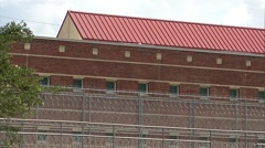Prison MS Federal Correctional Institution bldg-1 Stock Footage