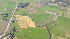 Flying above The Netherlands arriving at Schiphol Airport Amsterdam Stock Footage