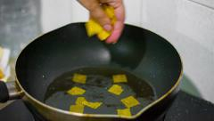 Crisps are prepared in a pan in hot oil. unhealthy food. Stock Footage