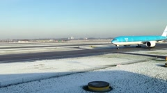 KLM airplane taxiing in the winter at Schiphol Airport - stock footage