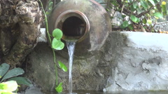 Old beautiful buddhist garden fountain with water splash Stock Footage