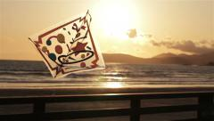 Kite Blowing in the Wind at Sunset Stock Footage