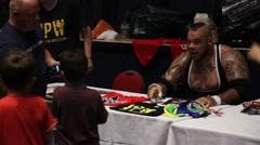 Stock Video Footage of WWE Wrestling Superstar Brodus Clay Autograph Signing - Celebrity HD