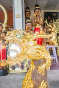 handicraft golden dragon made of wood - stock photo