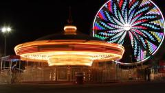 Carnival Ride - Ferris Wheel and Carousel Stock Footage