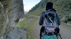Woman trekking in mountain - stock footage