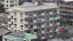 Urban Apartment Building In The City Of Beppu Japan With Laundry Hanging Out 4K Stock Footage